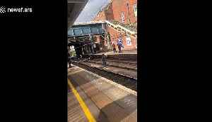 Heart-stopping moment man on track jumps to safety at last second at station in Essex, UK [Video]