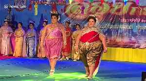 Plus size Thai women take part in beauty pageant to celebrate Buddhist festival [Video]