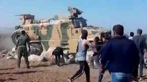 Turkish troops fired on Syria protesters: witness [Video]