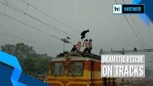 Watch: Officials rescue man dangling from overhead wire at MP's railway station [Video]