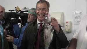 Farage poses with fish during Grimsby election campaign stop [Video]