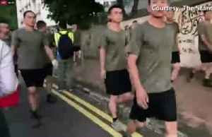China's PLA soldiers help clean up Hong Kong streets [Video]