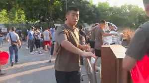 News video: China sends troops onto Hong Kong's street's to clean up after protests