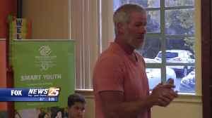 Brett Favre visits the Boys and Girls Club of the Gulf Coast [Video]
