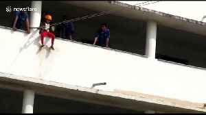 Terrifying moment a young girl falls 30 feet from zip line at Indian school [Video]