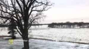 News video: Ice chunks flow down Red River on chilly fall day