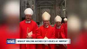 Returning from Rome, Bishop Malone avoids reporters and Catholics at airport [Video]