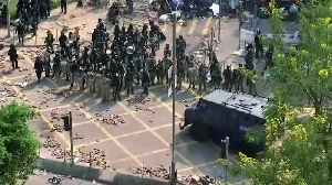 Hong Kong police lay siege at fortified university [Video]