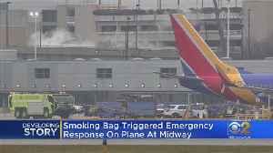 Smoking Bag Found On Plane At Midway [Video]