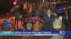 Rain Falls Across Orange County, Prompting Residents To Take Cover [Video]
