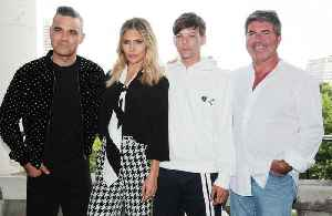 Robbie Williams loved not being centre of attention on X Factor [Video]