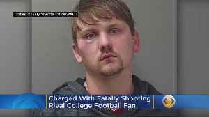 Man Charged With Fatally Shooting Rival College Football Fan [Video]