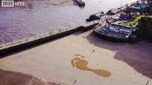 Giant Sand Footprints Appear On Beach [Video]