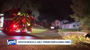 Summit County deputies hailed as heroes after rescuing elderly couple from house fire in Green [Video]
