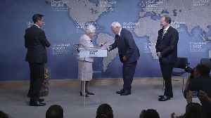 Queen makes joke as she presents prize to Sir David Attenborough [Video]