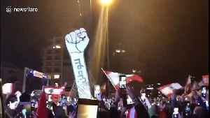 On Lebanon's Independence Day, giant protest symbol rises again after vandals burned it [Video]