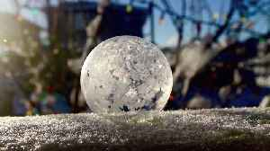 Soap bubble freezes instantly in real-time [Video]