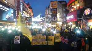 News video: Hong Kong protesters light up London's Leicester Square with glowing mobile phones