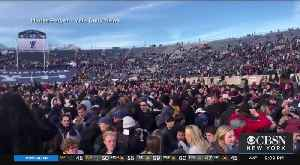 News video: Climate Change Protesters Disrupt Football Game