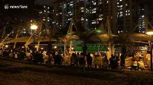 Hong Kong pro-democracy activists take respite from protests with night-time classical music concert in park [Video]