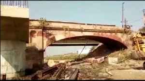 Construction workers make narrow escape as 200-year-old bridge collapses in India [Video]