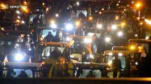 'Agri-bashing' protest continues as tractors plough thorugh Paris [Video]