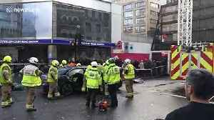 Emergency services cut person out of car after accident outside Tottenham Court Road station [Video]
