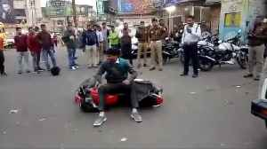 Man throws bike being fined for not wearing helmet [Video]