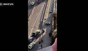 Police remove injured from London Bridge after deadly attack [Video]