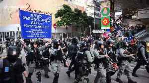 Hong Kong police pepper spray pro-democracy demonstrators on legal march [Video]