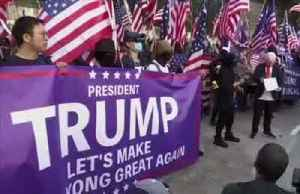Hong Kong protesters sing U.S. anthem to thank Trump [Video]