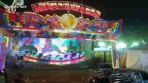 Police close fairground ride that ejected five people when safety bar opened [Video]