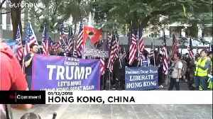 Hong Kong protesters hold US flags and praise Donald Trump [Video]