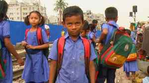 Bangladesh slum children drop out of school for full-time work