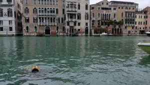 Scuba Divers Help Clean Up Venice Canals After Historic Flooding [Video]