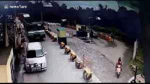 Shocking scene as container truck rams into toll booth on south Indian road [Video]