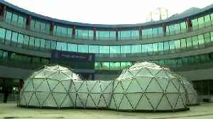 Climate summit pods replicate polluted air [Video]