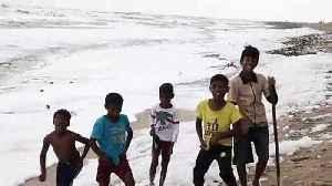 Children seen playing in 'toxic' foam blankets Indian beach [Video]