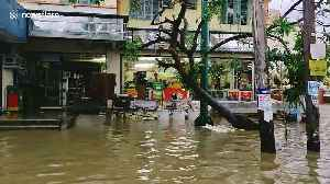 Residents wade through flooded streets after Typhoon Kammuri lashed the Philippines [Video]