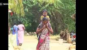 Determined mother in India has to carry disabled son 8km to school every day [Video]