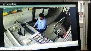 Indian toll booth camera shows employee sent flying back when truck smashes into his station [Video]