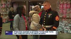 Pistons Owner and Marine Toys for Tots distribute gifts to kids in need [Video]