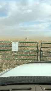 Huge Grain Storage Container Flies Across Windy Field [Video]