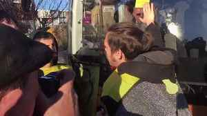 Climate change protester glues himself to Lib Dem bus [Video]