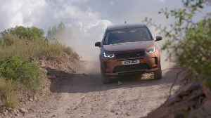 New Land Rover Discovery Sport in Namib Orange Off-Road Driving [Video]