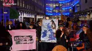 Climate activists in scuba gear deliver 'extreme weather forecast' outside BBC studio in London [Video]