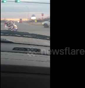 'I saw him run the red light': Man dressed as Santa spotted riding festively lit motorbike [Video]