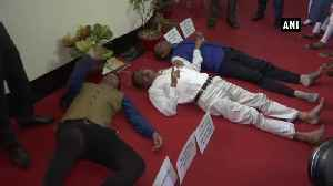Assam MLAs lie down on State Assemly floor over NRC New Land Policy issue [Video]