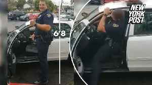 Very tall cop barely fits in his patrol car [Video]