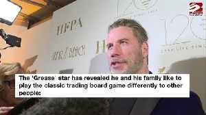 John Travolta plays Monopoly with real money [Video]